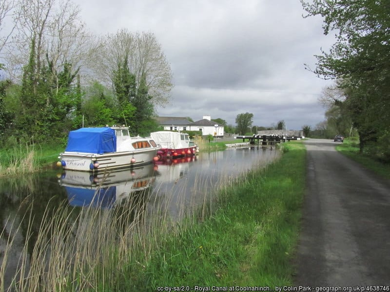 Boats moored to the side of a river
