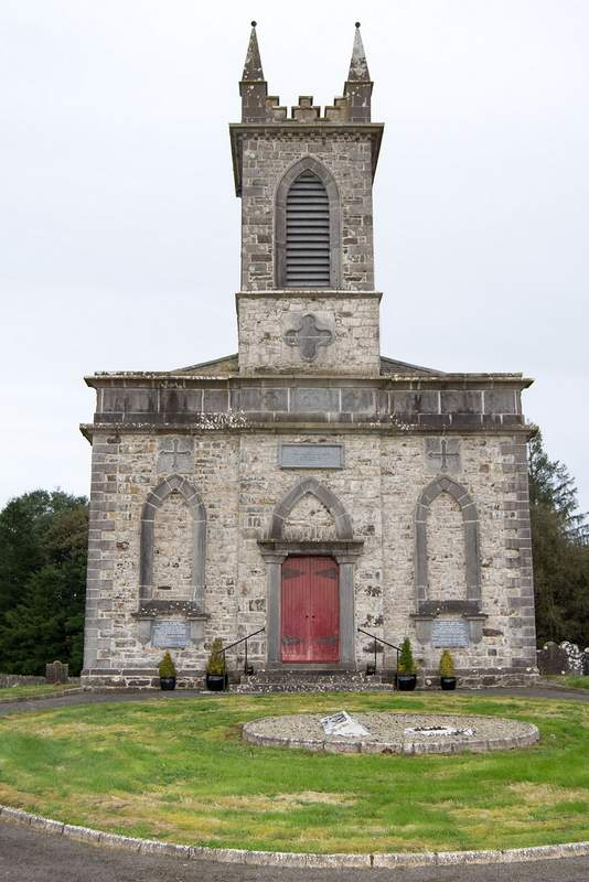 A stone church with a belfry
