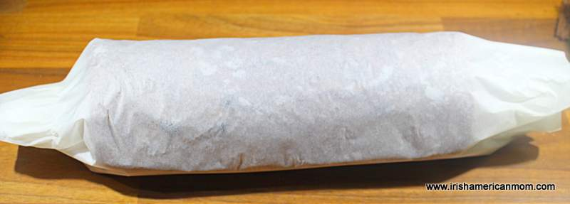 A cake rolled up in parchment paper
