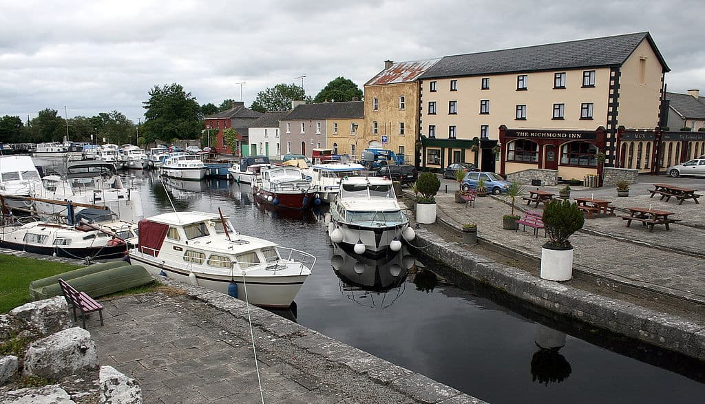 Boats beside a pier and old stone buildings