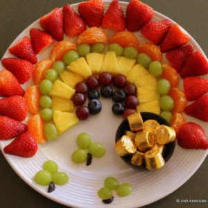 Irish fruit rainbow for Saint Patrick\'s Day served on a white plate