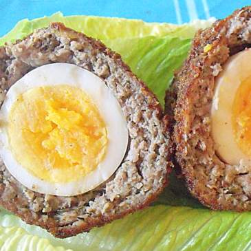 Scotch eggs for lunch served on lettuce leaves