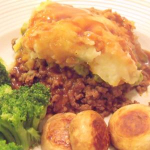 Shepherds pie with Guinness served with broccoli and seared mushrooms