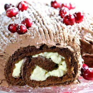 Christmas yule log Irish recipe with cranberries and fresh cream