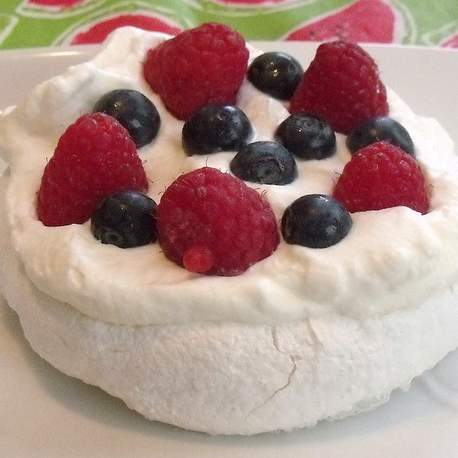 Individual pavlovas with fruit and fresh cream