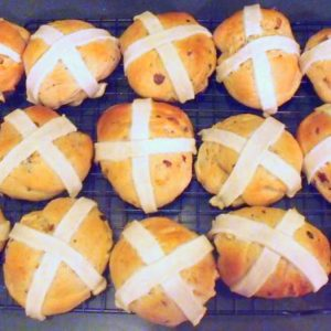 Hot cross buns cooling on a wire rack