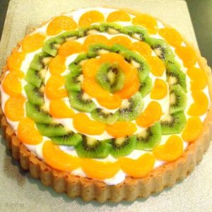 Irish fruit and cream sponge flan with mandarin orange and kiwis