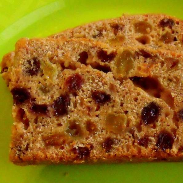 Slice of Irish tea brack showing raisins and currants up close