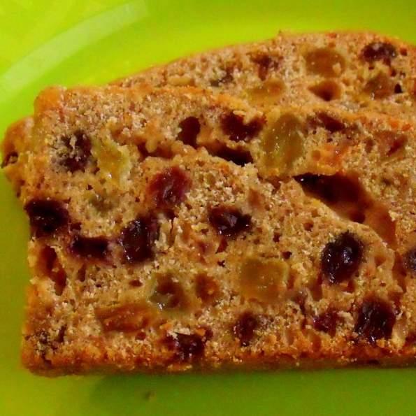 Slice of Irish tea brack showing raisins and currants up close