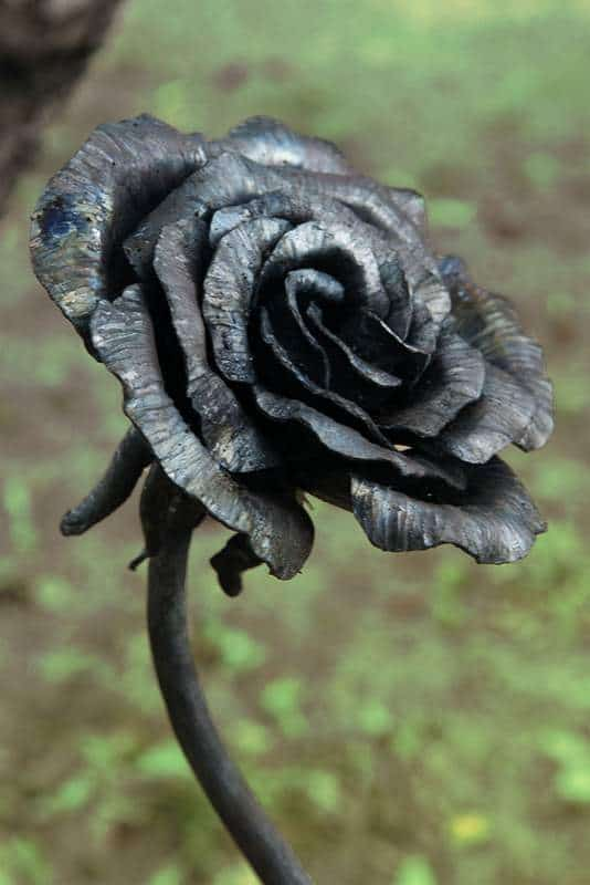 A black rose made from metal