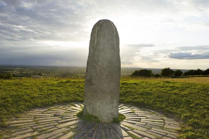 A stone pillar on a hilltop