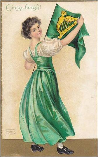A person in a green dress holding a flag