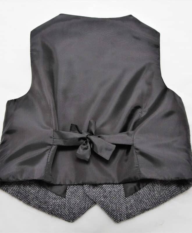 Satin lining back of a boys herringbone tweed waistcoat or vest