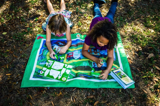 Two children playing on a playmat