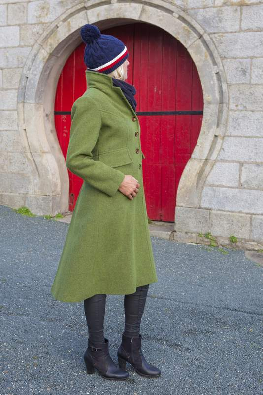 Green tweed ladies coat with a high low hemline