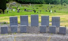 Stone memorials beside the mass Famine grave in Skibbereen