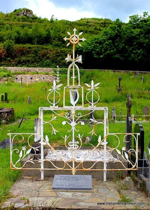 Iron memorial art work with harp in Skibbereen graveyard
