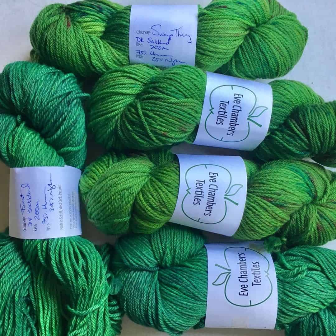 Five skeins of green Irish wool in two shades of green