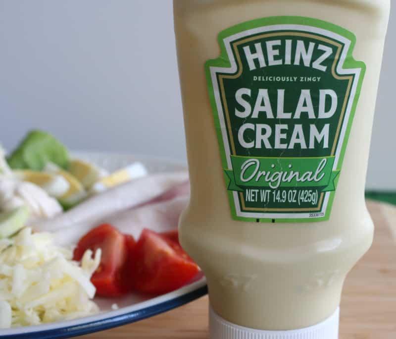 A bottle of Heinz salad cream beside a plate of Irish salad.
