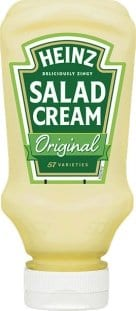 A green and white labeled bottle of Heinz salad cream from England or Ireland