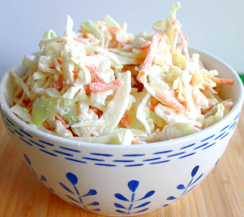 A blue and white bowl of Irish cabbage and carrot creamy coleslaw