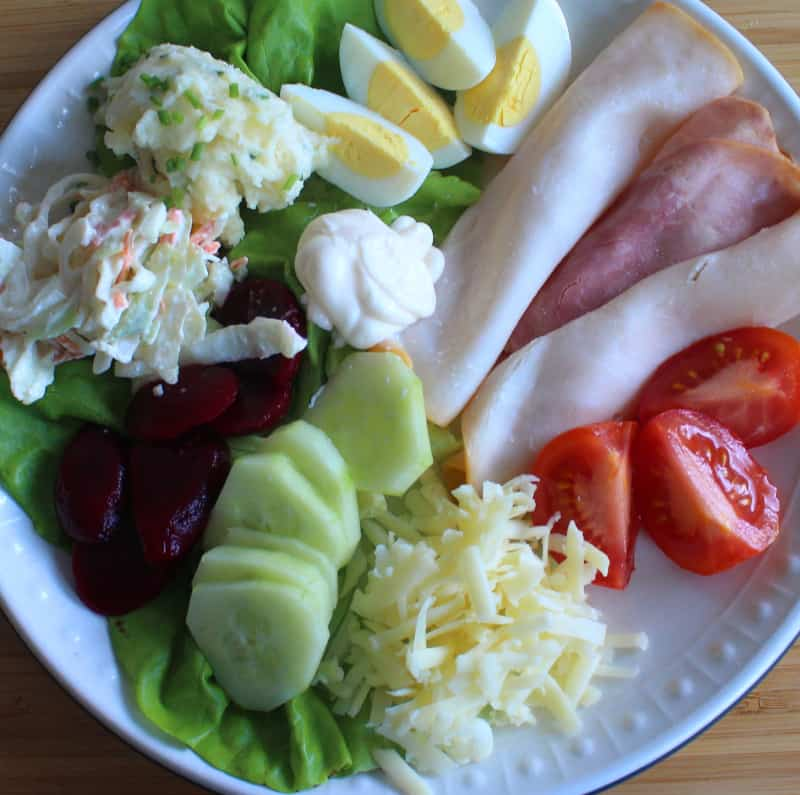What to include in an Irish salad meat, tomato, lettuce, boiled egg, cucumber, beets, coleslaw, grated cheese and mashed potato salad