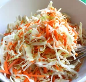 Shredded carrots and white cabbage in a bowl for making an Irish coleslaw recipe.