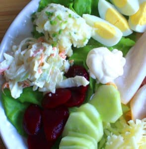 An Irish pub salad often features a spoon of creamy coleslaw