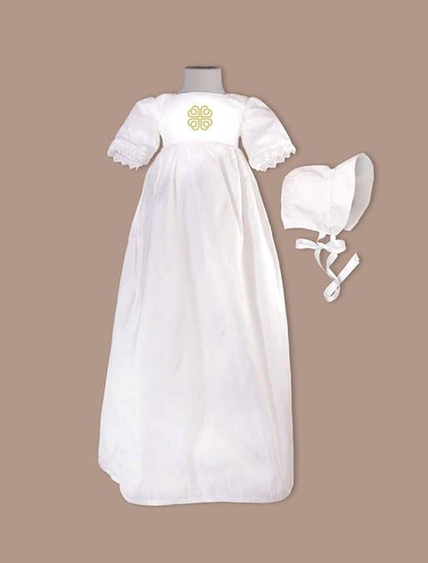 A silk white christening gown from Ireland with a Celtic embroidered emblem.