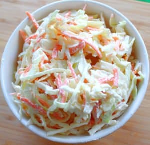 Looking down on a bowl of carrot and cabbage creamy Irish coleslaw.