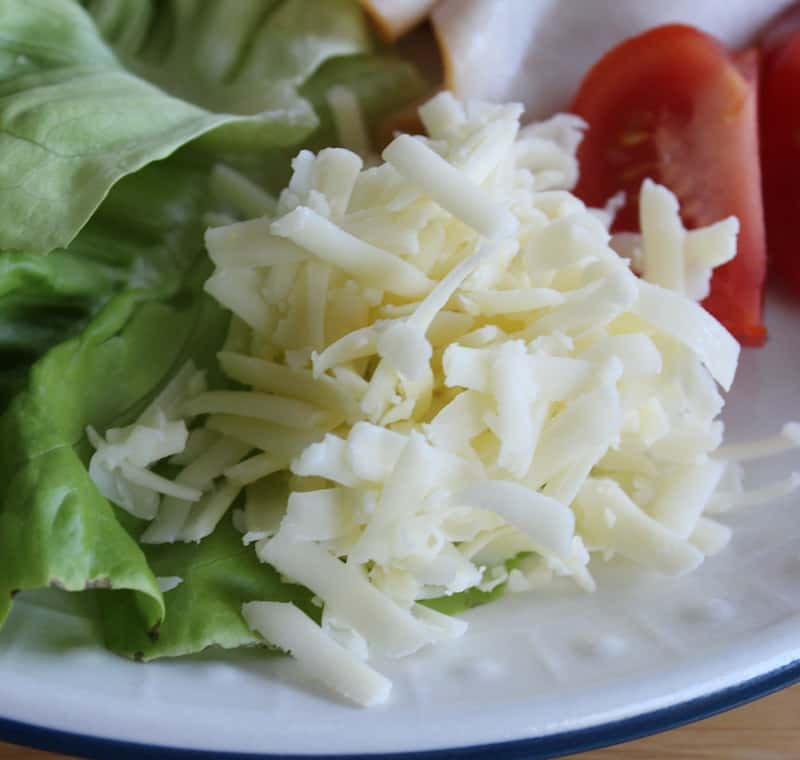 Grated white cheddar cheese is served as a part of an Irish salad