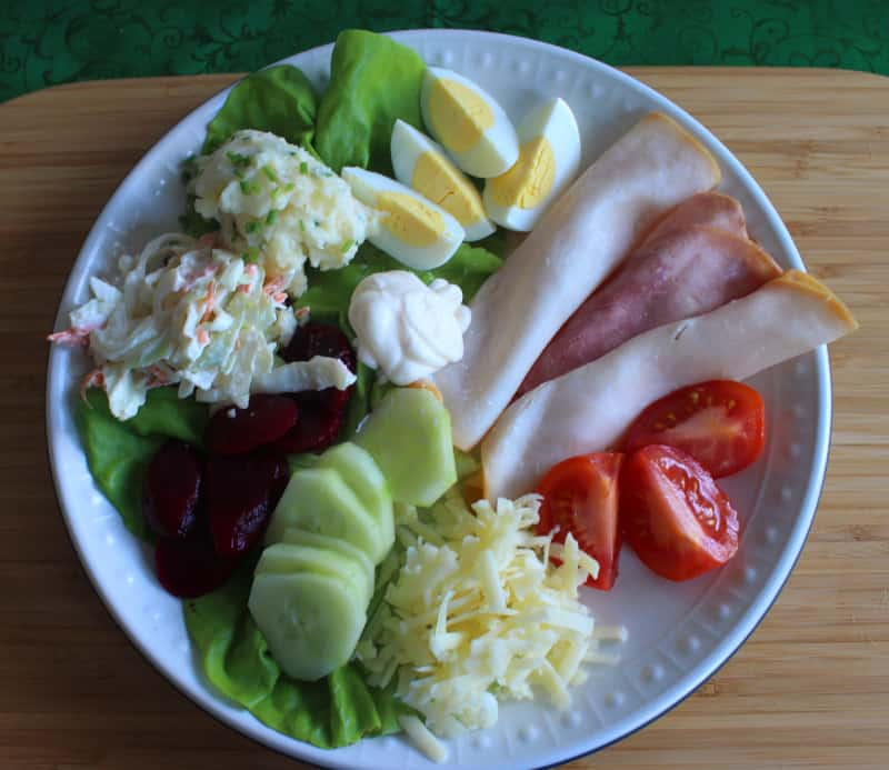 Lettuce, eggs, meat, tomato, cheese, cucumber, beetroot,coleslaw and potato salad with mayonnaise on an Irish salad plate.