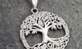 Intricate Celtic patterns around a Tree of Life on a sterling silver pendant