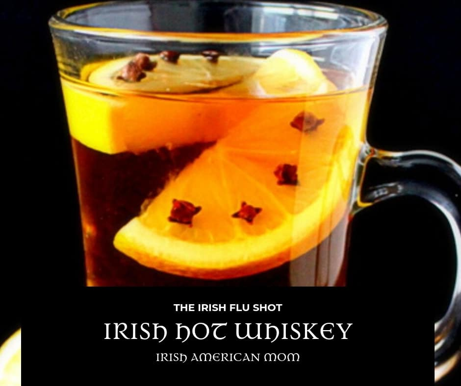 A clove studded lemon floating in an Irish hot whiskey