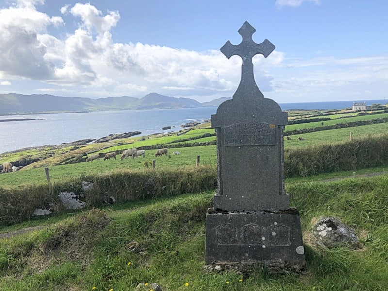 View of the Irish coastline and an old headstone