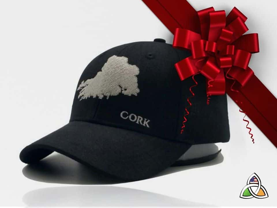 A black baseball hat with an embroidered design of County Cork Ireland