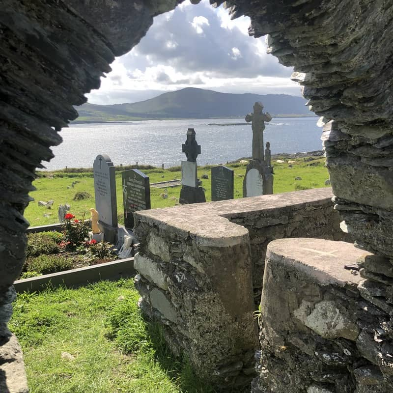 A stone archway in the cemetery on Dursey Island looking out toward the mainland and over the ocean