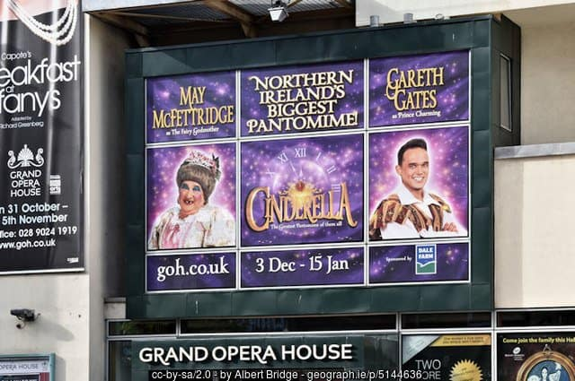 Poster for a pantomime at the Belfast Grand Opera House featuring Cinderella