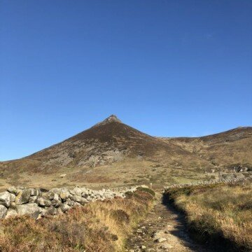 The peak of Slieve Binnian in the Mountains of Mourne under a clear blue sky