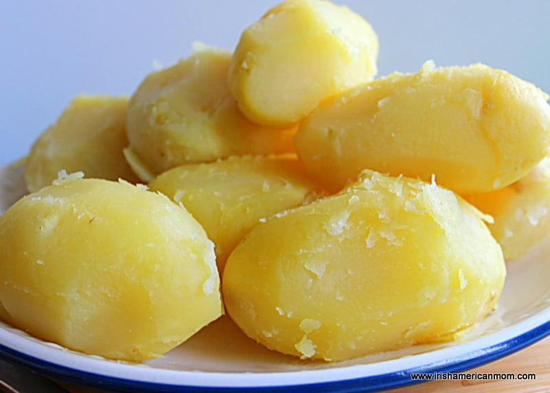 An enamel plate with peeled and boiled potatoes