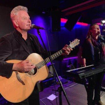 John Lindsay playing a guitar with voalist Grainne McGlone
