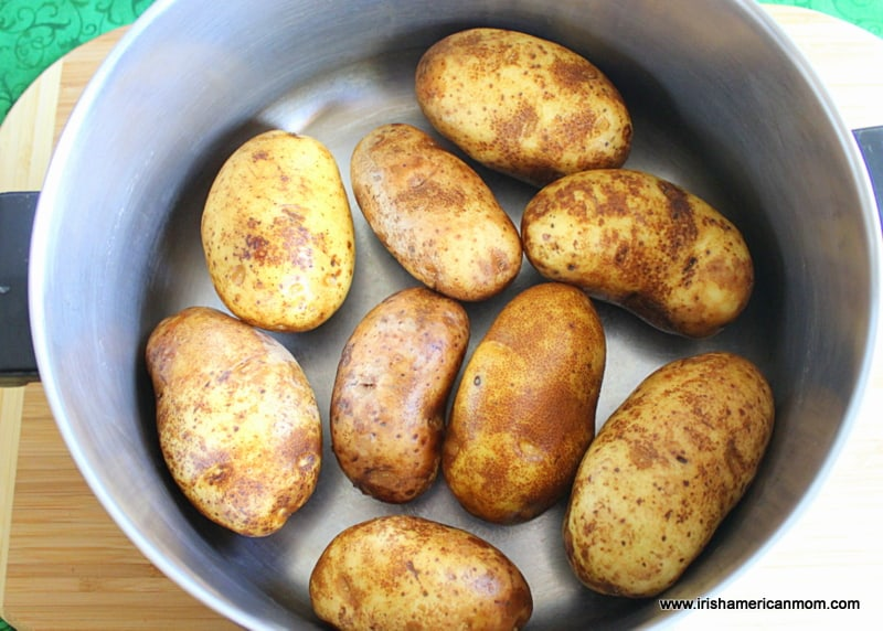 Potatoes at the bottom of a large saucepan