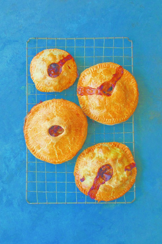 Four Irish pastry Dingle pies cooling on a wire rack