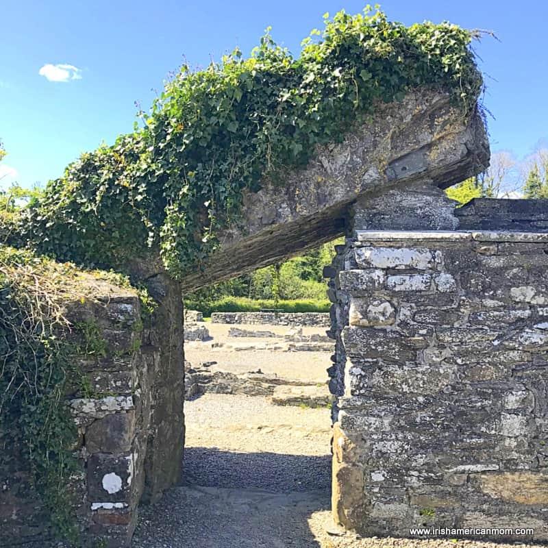 A fallen slab over an old church wall forming a portal at an Irish monastic site