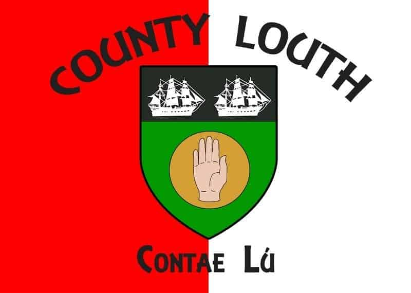 Red and white flag of County Louth with a county crest featuring two ships and a hand