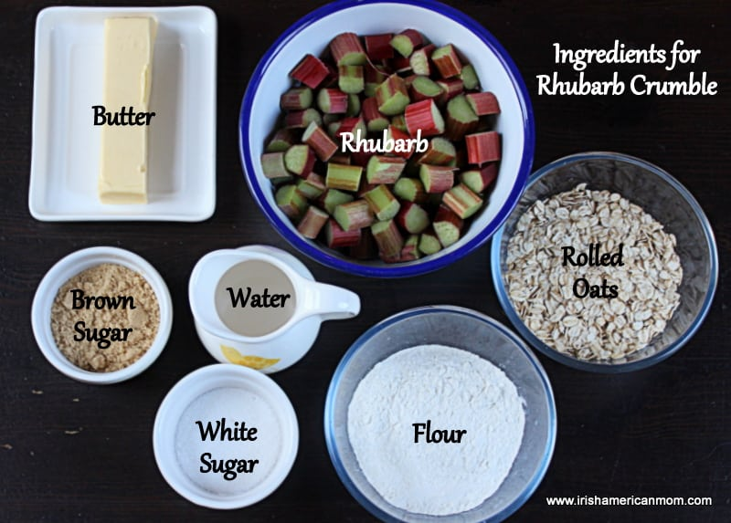 Ingredients for Rhubarb Crumble showing chopped rhubarb, butter, oats, flour, water, brown sugar and white sugar