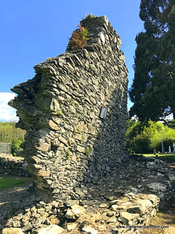 A leaning stone wall of a ruined church
