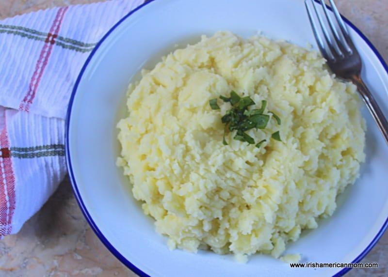 A large bowl full of floury mashed potatoes