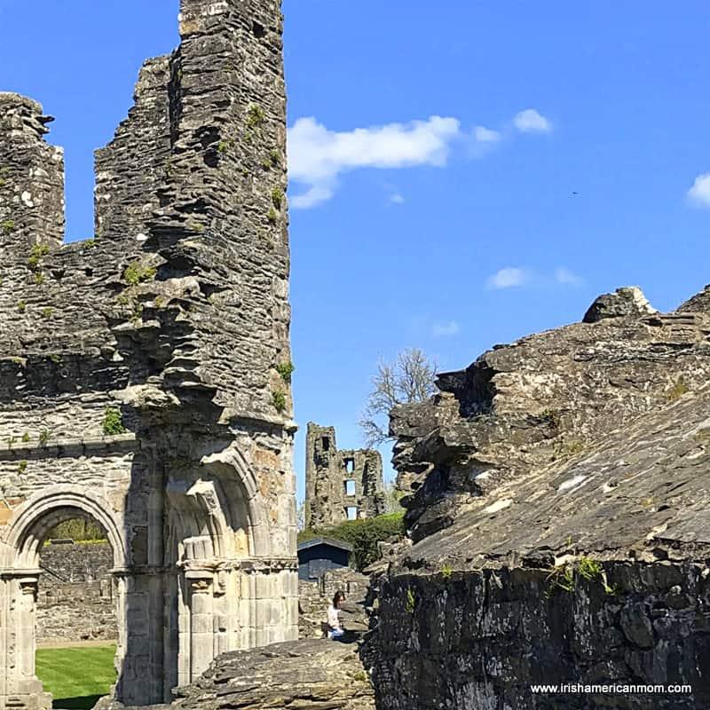 Ruined stone buildings beneath a blue sky