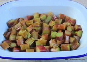 Chopped rhubarb parboiled with sugar to form the base of a rhubarb crumble